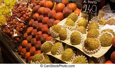 Large Counter with Fruits at a Market in La Boqueria. Barcelona. Spain