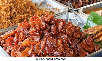 Large counter with various jerky meat. Counter with variety...