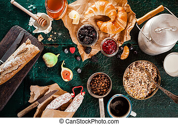 Large country breakfast spread with muesli, honey , bread, ...