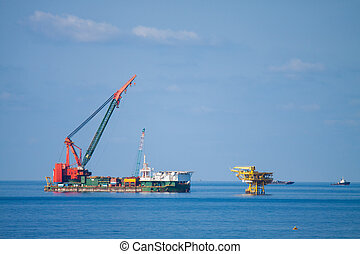Large crane vessel installing the platform in offshore,crane...
