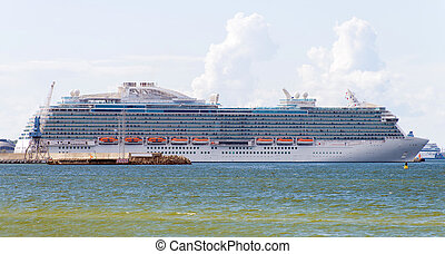 Large cruise ship in port on mooring.