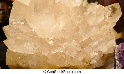 Large crystals of white quartz on dark background