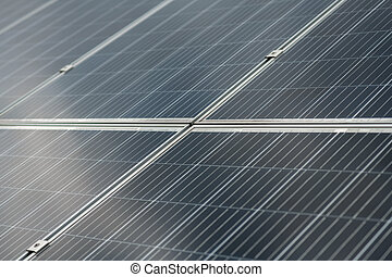 Providing energy. Large, perfectly flat dark gray surface of solar panel consisting of identical sections and mountings