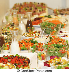 Large, delicious buffet of various dishes - square