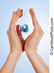 large drop of water - A large drop of water with Earth...