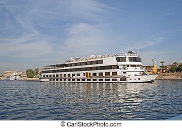 Large egyptian river cruise boat sailing on Nile