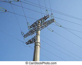 Large electric pole with wires on a blue sky background