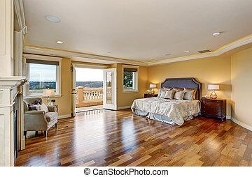 Large elegant master bedroom with fireplace.