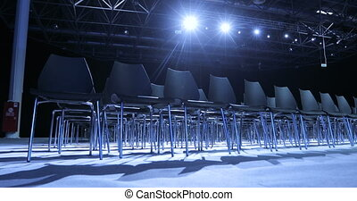 large Empty conference hall with rows of seats for...