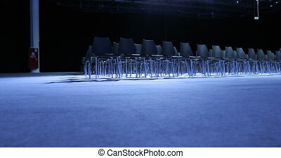 large Empty conference hall with rows of seats for spectators and audience.