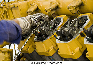 Large engine maintenance II - A technician performing ...