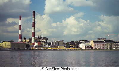 Large factory with chimney-stalks on city quay - View on...