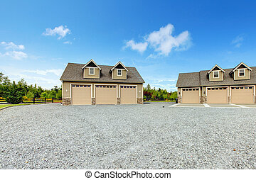 Large farm country house with gravel driveway and green ...