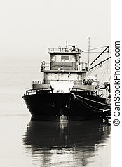 Large fish processing boat in the deep water dock. photo