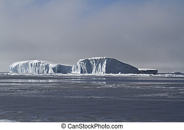 large flat iceberg in the freezing waters of the Antarctic