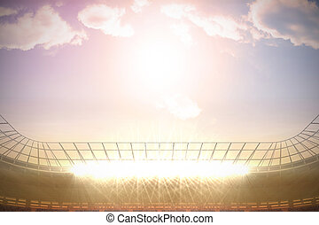 Large football stadium with spotlights under morning sky