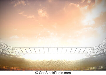 Large football stadium with spotlights under pink sky