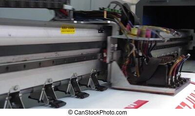 Large format inkjet printing press in operation. Working...