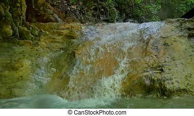 Large fragments nature stones of rock in water of mountain...