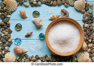 large frame with pebbles stones rocks seashells