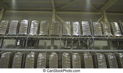 Large furniture warehouse. Mezzanine shelving with large...
