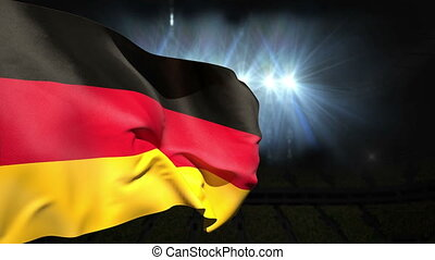 Large german national flag waving on black background with...