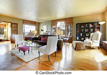 Large gold antique living room interior with hardwood floor.