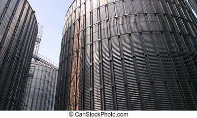 Large grain silo for storing barley. Metal steel building,...