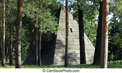 large granite pyramid in the forest