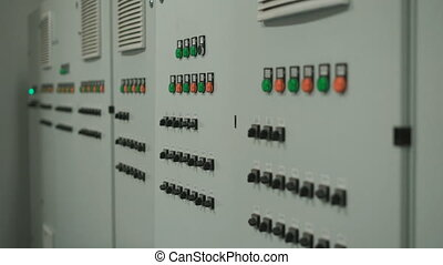 Large gray control panel with lots of buttons and switches. ...