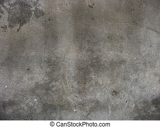 large gray worn concrete wall with some damage