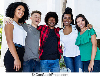Large group of brazilian young adults arm in arm
