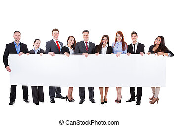 Large group of businesspeople presenting banner