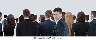 Large group of businesspeople standing back side