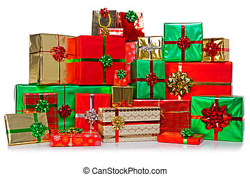 A large group of gift wrapped Christmas presents in a colourful variety of wrapping paper with ribbons and bows, isolated on a white background.