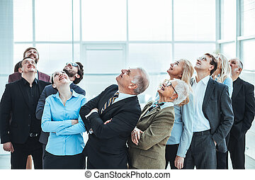 large group of diverse business people looking up.