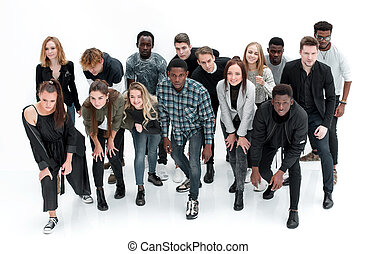 large group of diverse young people starting forward