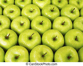 green apples - large group of green apples in a row....