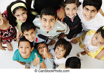 Large group of happy children, different ages and races,...