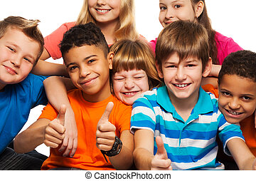 Large group of diversity happy kids boys and girls of age 8-11 years old with one of them thumbs up and smile