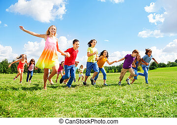 Large group of kids running in the park
