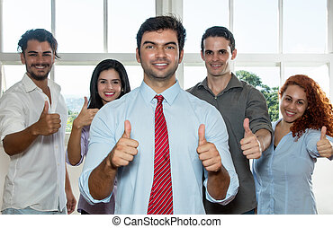 Large group of successful businesspeople showing thumbs up