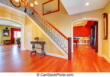 Large hallway with gold and red walls. - Large hallway and ...