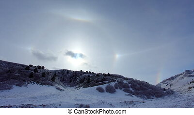 Large halo around the sun on a winter day in mountains....