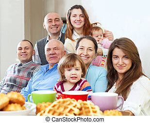 large happy family having tea