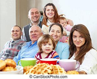 large happy family having tea