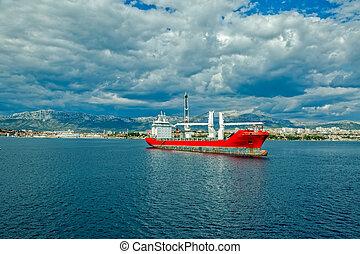 Large heavy lift ship - A large heavy lift ship anchored in...