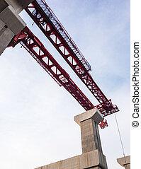 Large high crane on the concrete pillar.
