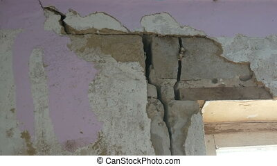 Large holes and cracks in a concrete wall - Large holes and...