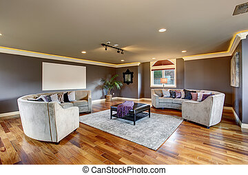 Large home theater living room with gray sofas.